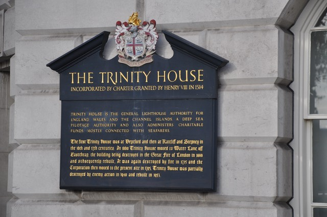 A sign on the wall of Trinity House giving a brief history of the Corporation of Trinity House and its role in maintaining lighthouses and navigational beacons around the seas of England, Wales and the Channel Islands.