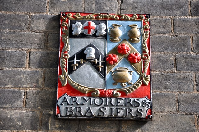 A photo of the Coat of Arms of the Armourers and Brasiers' Company taken from the wall outside their hall in the City. Below the Coat of Arms are the words Armorers & Brasiers with the word Armorer spelt without a U.
