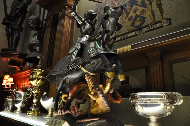 A metal statue of St George slaying the Dragon. This statue is on a mantlepiece in Armourers and Brasiers' Hall.