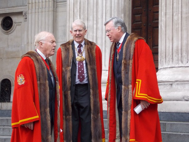 The Master and Wardens of The Worshipful Company of Fanmakers in their robes and regalia on the steps of St Paul's Cathedral in the City of London on the occasion of the annual United Guilds Service.
