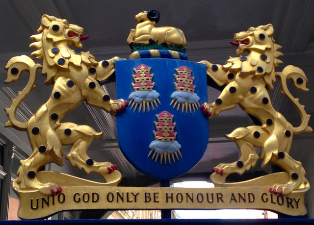 The Coat of Arms of the Worshipful Company of Drapers above a gate adjacent to their hall.