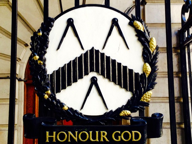 The Coat of Arms of The Worshipful Company of Carpenters on a gate outside their hall.